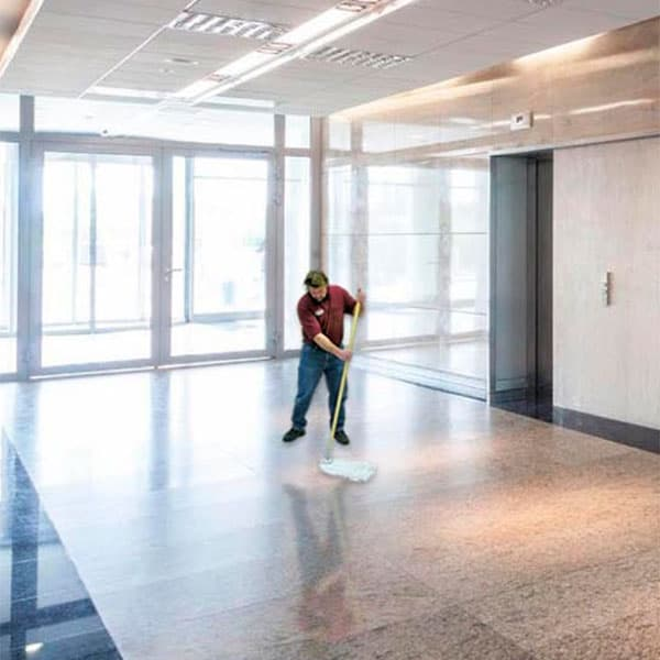 Leadens team member performing janitorial services in office building, Minnesota
